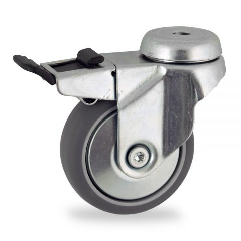 Zinc plated total lock castor 75mm for light trolleys,wheel made of grey rubber,double ball bearings.Bolt hole fitting