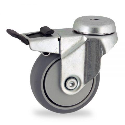 Ρόδα με φρένο 75mm για καρότσι ελαφρύ,με τροχό από Γκρι λάστιχο χωρίς ρουλεμάν και με πλαστικά καπάκια.Προσαρμογή με τρύπα.
