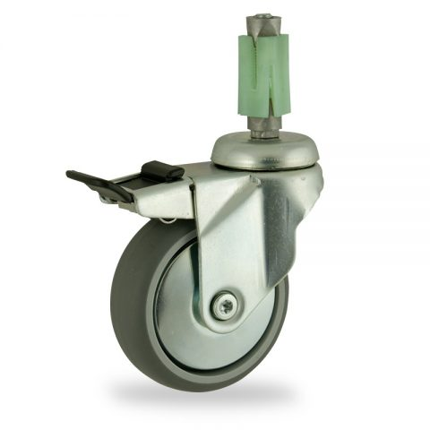 Zinc plated total lock castor 100mm for light trolleys,wheel made of grey rubber,double ball bearings.Fitting with square expander 27/31