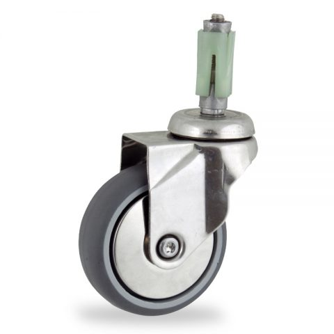 Stainless swivel castor 100mm for light trolleys,wheel made of grey rubber,double ball bearings.Fitting with square expander 31/35